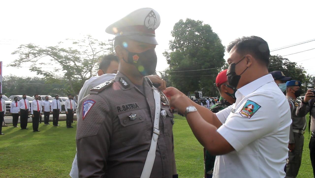 Bupati Dharmasraya Pimpin  Apel Gelar Pasukan Operasi Ketupat 2021